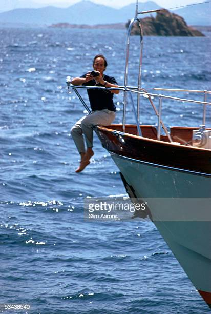 Prince Karim Aga Khan perches on the prow of his yacht on the Costa Smeralda Sardinia 1967