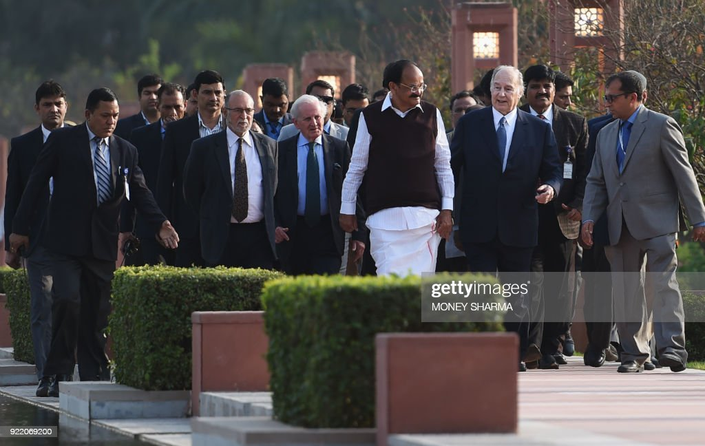 Prince Karim Aga Khan (2R) walks with Indian Vice-President Venkaiah Naidu (3R) as they arrive for the inauguration of the Sunder Nursery, a 16th-century heritage garden complex adjacent to Indian UNESCO site Humayun's Tomb, in New Delhi on February 21, 2018. A once-forgotten Mughal garden in the heart of New Delhi will reopen on February 21 after years of painstaking conservation work, creating a new public park in India's sprawling and smog-choked capital. /