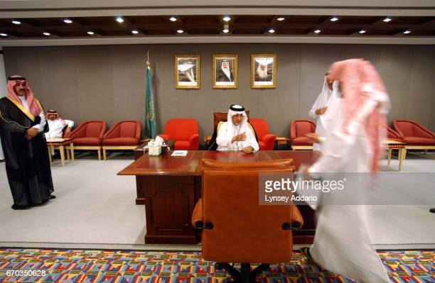 Prince Khalid bin Faisal son of King Faisal meets with the leader of WHO in the Middle East at his office in Abha in Asseer province October 2003