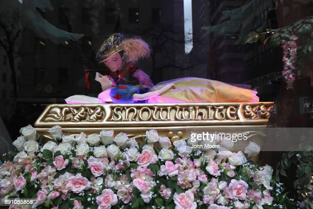 A prince kisses a sleeping Snow White at an iconic holiday window at Saks Fifth Avenue on December 12 2017 in New York City Security in the city...