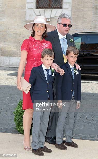 Prince Laurent and Princess Claire of Belgium with children arrive at the wedding of Prince Amedeo Of Belgium and Elisabetta Maria Rosboch Von...