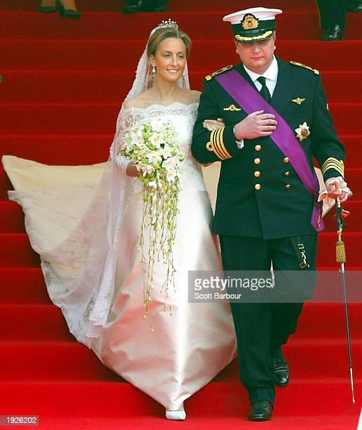 Prince Laurent of Belgium and his bride Claire Coombs leave the Cathedral of St. Michael and St. Gudula after their marriage ceremony April 12, 2003...