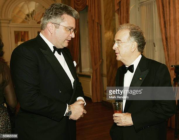 Prince Laurent of Belgium and Portuguese President Jorge Sampaio toast during a reception at the Cercle Gaulois in Brussels on October 19 2005 in the...
