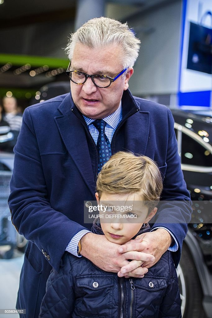 Prince Laurent of Belgium (L) and Prince Aymeric visit on January 20, 2016 the 94th edition of the European Motor Show Brussels, which is open to the public from January 14 to 24, at Brussels Expo. / AFP / BELGA / LAURIE DIEFFEMBACQ / Belgium OUT