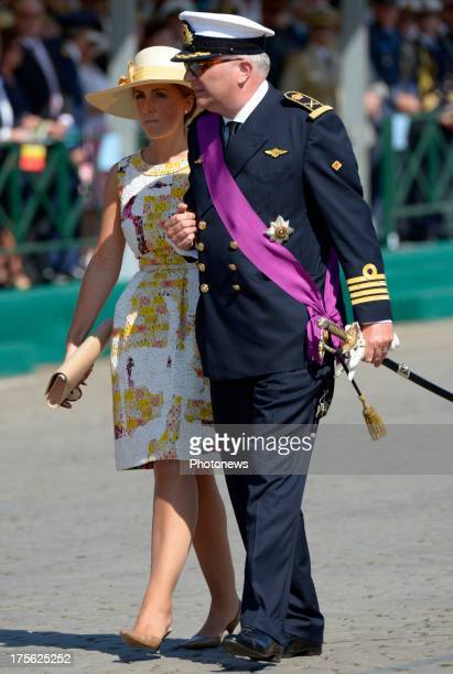 Prince Laurent of Belgium and Princess Claire of Belgium watch the Military Parade on July 21, 2013 in Brussels, Belgium.