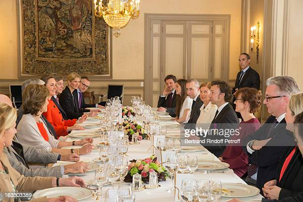 Prince Laurent of Belgium , French journalist and author Stephane Bern , Princess Claire of Belgium and guests prepare to share a meal after Bern was...