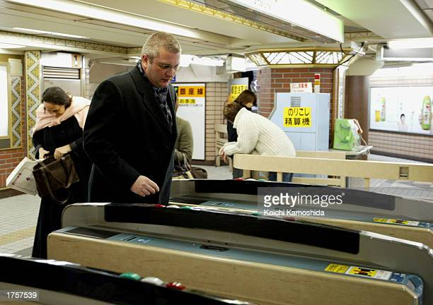 Prince Laurent of Belgium goes through the ticket gate of a subway station February 2 2003 in Tokyo Laurent is visiting Japan until February 5
