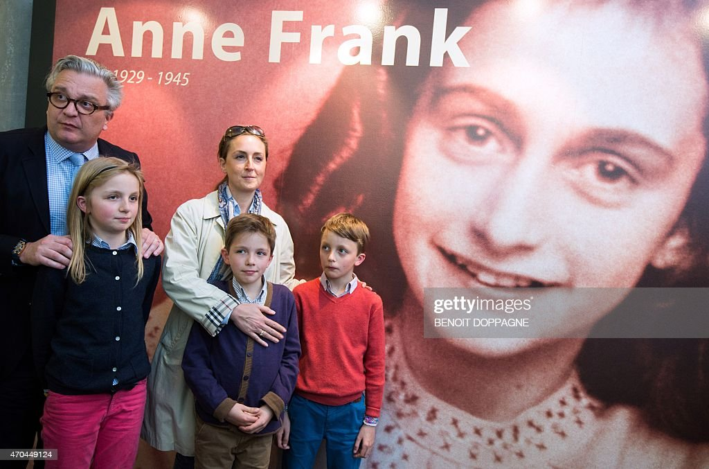 Prince Laurent of Belgium (L) his wife Princess Claire of Belgium (C) and their children (from L) Princess Louise, Prince Aymeric and Prince Nicolas pose during a royal visit to the exhibition 'La maison d'Anne Frank' (Anne Frank House) in Stavelot on April 20, 2015. The exhibition is open until February 14, 2016.