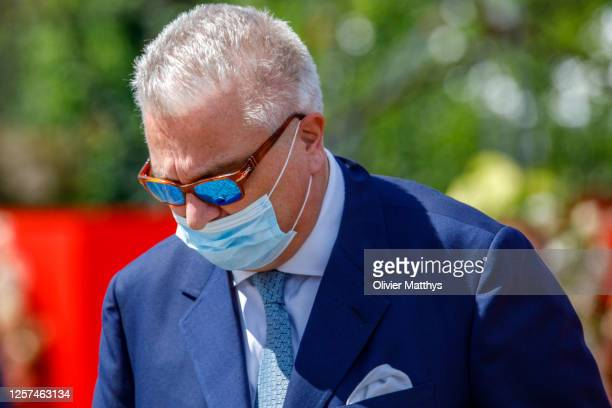 Prince Laurent of Belgium of Belgium wears a protective mask during the ceremony in front of the Royal Palace on the occasion of the National Day on...