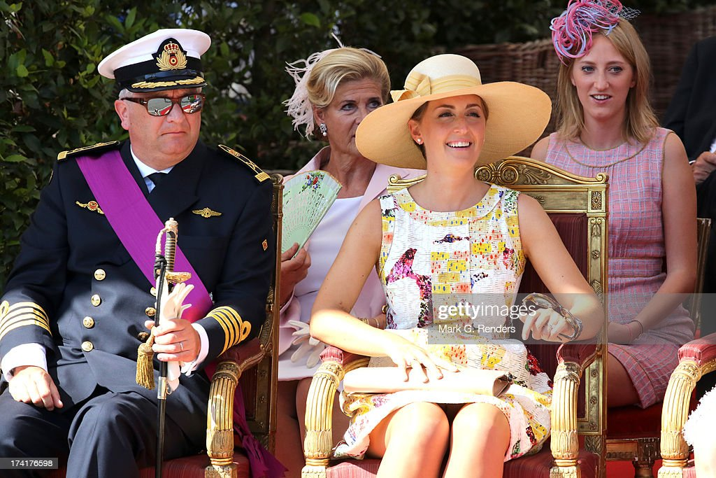 Prince Laurent of Belgium, Princess Claire of Belgium and Princess Luisa Maria of Belgium (2nd Row R) seen at the Civil and Military Parade during the Abdication Of King Albert II Of Belgium, & Inauguration Of King Philippe on July 21, 2013 in Brussels, Belgium.