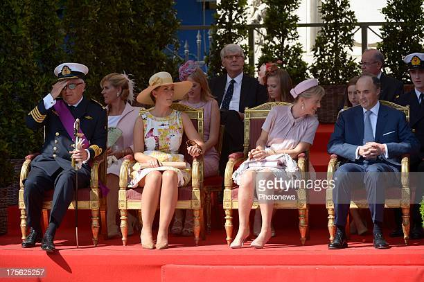 Prince Laurent, Princess Claire, Princess Astrid and Prince Lorenz of Belgium watch the Military Parade on July 21, 2013 in Brussels, Belgium.