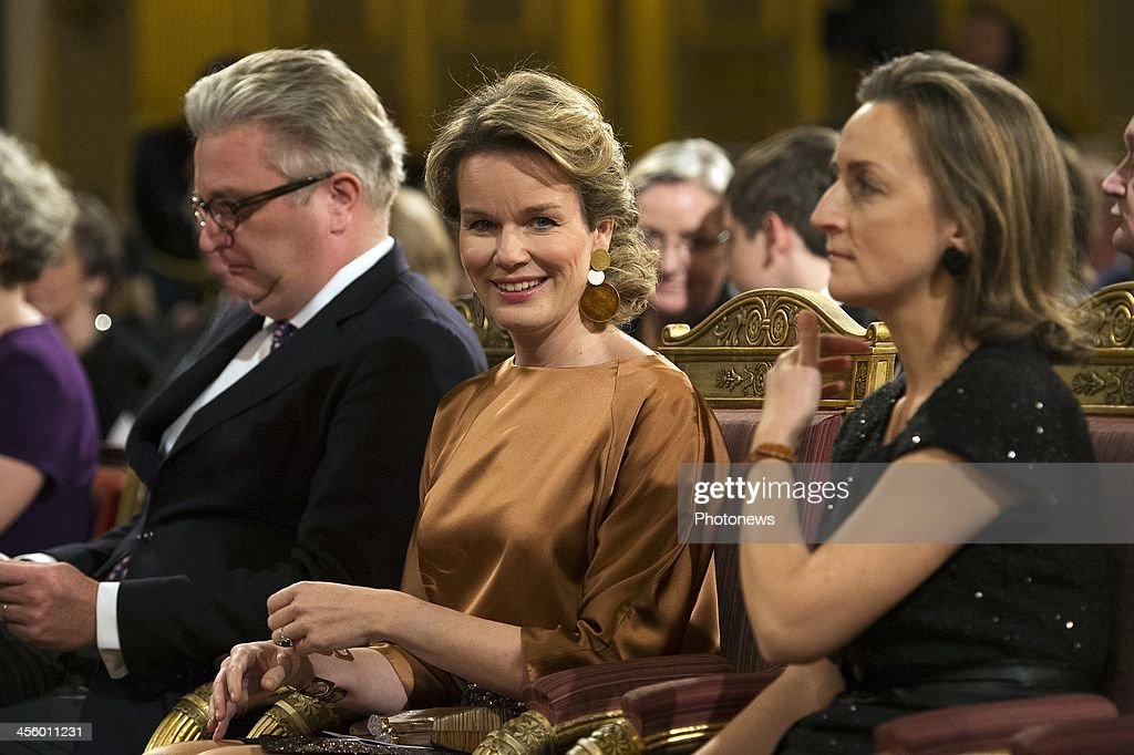 Prince Laurent, Queen Mathilde and Princess Claire of Belgium attend the Christmas concert held at the Royal Palace on December 11, 2013 in Brussels, Belgium.