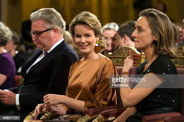 Prince Laurent, Queen Mathilde and Princess Claire of Belgium attend the Christmas concert held at the Royal Palace on December 11, 2013 in Brussels,...