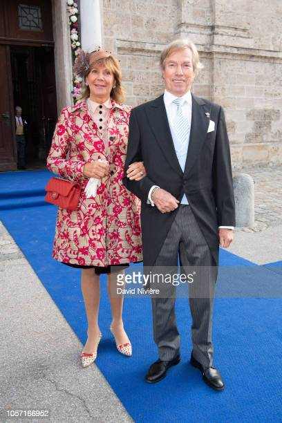 Prince Leopold of Bayern and Princess Ursula of Bayern arrive at the SaintQuirin Church for the wedding of Duchess Sophie of Wurttemberg and Count...