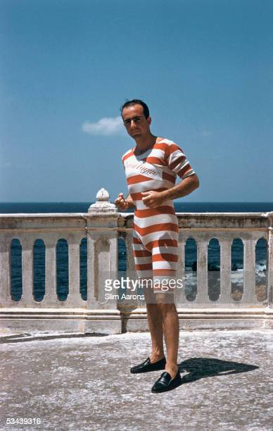 Prince Lillio Sforza Ruspoli wearing an oldfashioned red and white striped swimsuit in Sicily 1954