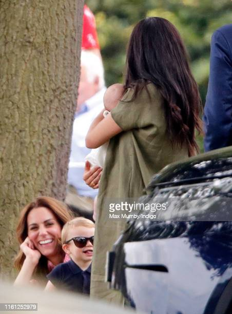 Prince Louis of Cambridge Catherine Duchess of Cambridge Meghan Duchess of Sussex and Archie Harrison MountbattenWindsor attend the King Power Royal...