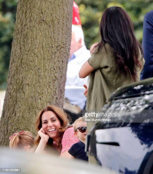 Prince Louis of Cambridge, Catherine, Duchess of Cambridge, Meghan, Duchess of Sussex and Archie Harrison Mountbatten-Windsor attend the King Power...