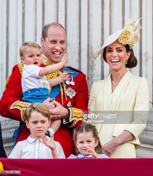Prince Louis Prince George Prince William Duke of Cambridge Princess Charlotte and Catherine Duchess of Cambridge appear on the balcony during...