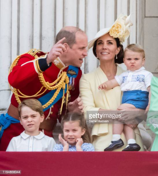 Prince Louis, Prince George, Prince William, Duke of Cambridge, Princess Charlotte and Catherine, Duchess of Cambridge appear on the balcony during...