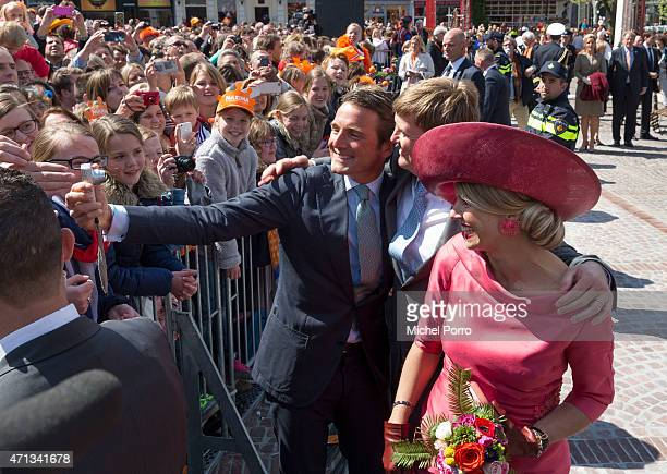 Prince Maurits King WillemAlexander and Queen Maxima of The Netherlands take a selfie during King's Day on April 27 2015 in Dordrecht Netherlands