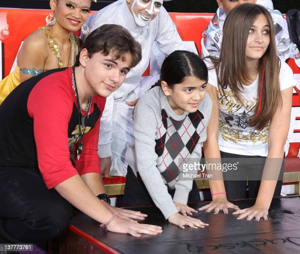 "Prince Michael Jackson, Blanket Jackson and Paris Jackson attend the Michael Jackson ""Immortalized"" hand and footprint ceremony held at Grauman's..."