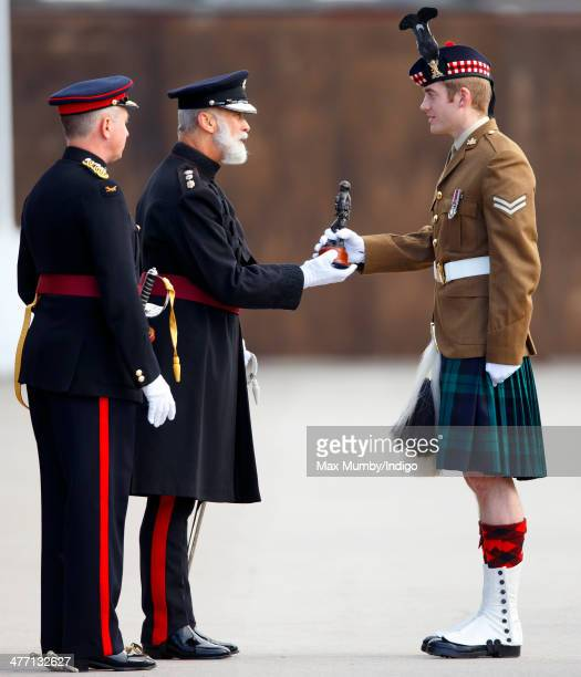 Prince Michael of Kent presents prizes to award winning soldiers as he attends the 76 Battery Royal Artillery Pass Off Parade at Alexander Barracks...