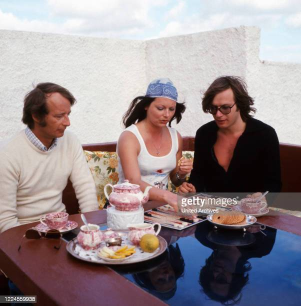 Prince Michael of Prussia, playing with friends backgammon on holiday in Mallorca, Spain 1970s.