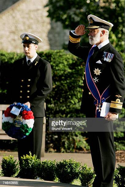 Prince Michael the Duke of Kent salutes the ensign at the Merchant Navy Falklands War Memorial in Trinity Gardens after a sunset ceremony on June 15...