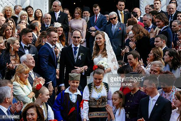 Prince Mihailo Karadjordjevic and his bride Ljubica Ljubisavljevic pose after exiting the church after their wedding ceremony on October 23 2016 at...