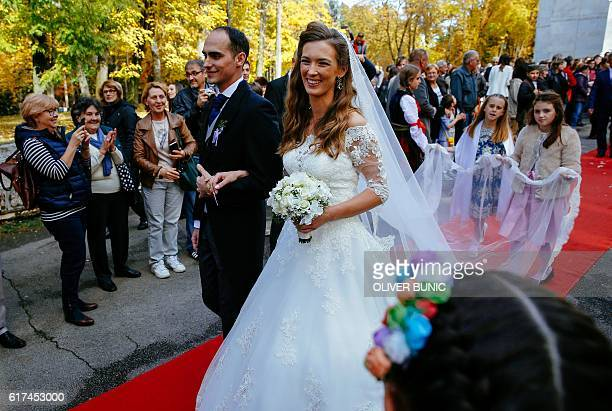Prince Mihailo Karadjordjevic and his bride Ljubica Ljubisavljevic exit the church after their wedding ceremony on October 23 2016 at the St George's...