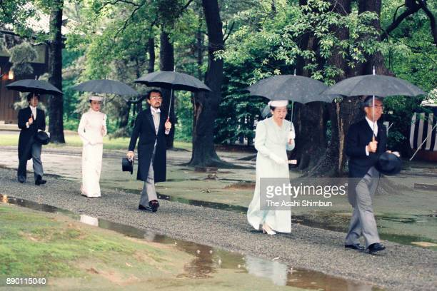 Prince Mikasa Pirncess Yuriko of Mikasa Prince Tomohito of Mikasa Princess Nobuko of Mikasa and Prince Takamado walk to the Kashikodokoro prior to...