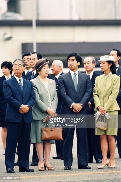 Prince Mikasa Princess Yuriko of Mikasa Prince Takamado and Princess Hisako of Takamado see off Emperor Akihito and Empress Michiko departing for...