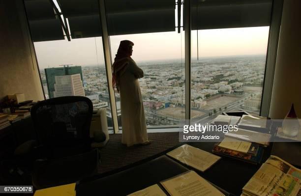 Prince Mohammad KA AlFaisal grandson of two kings walks with his children around his pool in Riyadh Saudi Arabia October 2003