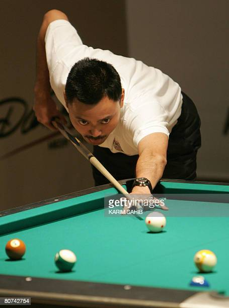 Prince Muhtadee Billah of Brunei sets up a shot during the opening match of the third annual World 8Ball Championship in the Gulf Emirate of Fujeirah...