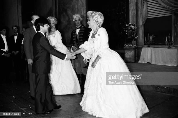 Prince Naruhito greets performers after watching the Royal Opera performance at the Tokyo Bunka Kaikan on October 6 1986 in Tokyo Japan