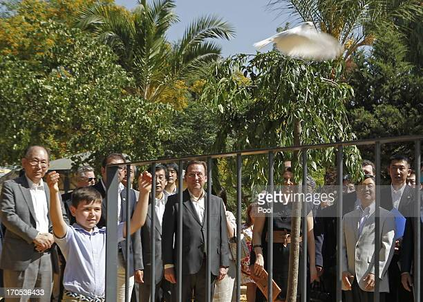 Prince Naruhito of Japan looks on as a young boy watches a cheery tree planting ceremony in Coria del Rio on June 14 2013 in Sevilla Spain Japanese...