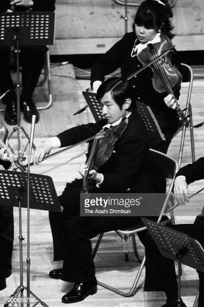 Prince Naruhito plays viola during a concert on April 15 1986 in Tokyo Japan
