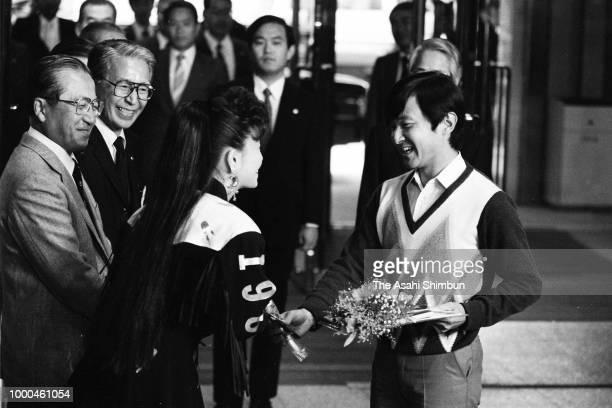 Prince Naruhito presents a flower to singer Yoshie Kashiwabara after her recital at Kosei Nenkin Kaikan on October 19 1986 in Tokyo Japan
