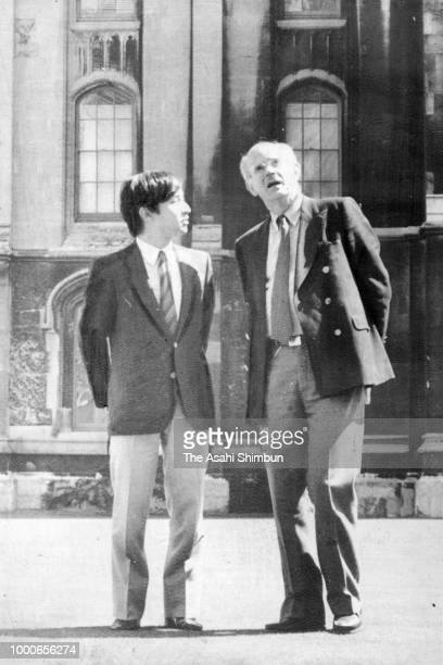 Prince Naruhito talks with professor Peter Mathias at the Oxford University on July 24 1986 in Oxford England