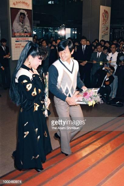 Prince Naruhito talks with singer Yoshie Kashiwabara after her recital at Kosei Nenkin Kaikan on October 19 1986 in Tokyo Japan