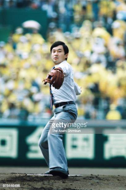 Prince Naruhito throws a ceremonial first pitch during the opening ceremony of the 70th All Japan High School Baseball Tournament at Hanshin Koshien...