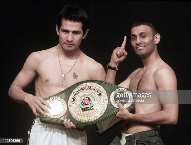 Prince Naseem Hamed from England and Marco Antonio Barrera from Mexico pose with the IBO Featherweight Champion belt following the weighin at the MGM...