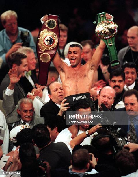 Prince Naseem Hamed of Sheffield England carries both the WBO and WBC belts after defeating Ceasar Soto of Juarez City at Joe Louis Arena in Detroit...