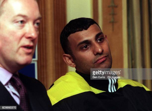 Prince Naseem Hamed sits beside boxing promoter Frank Warren during a news conference in London to announce his next title defence at the Nynex Arena...