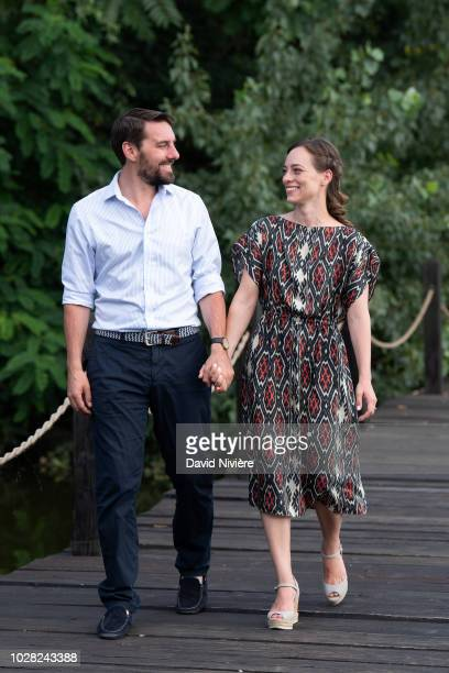 Prince Nicholas Of Romania and Princess Alina Of Romania hold hands while walking during a summer photo session in a public park on August 04 2018 in...