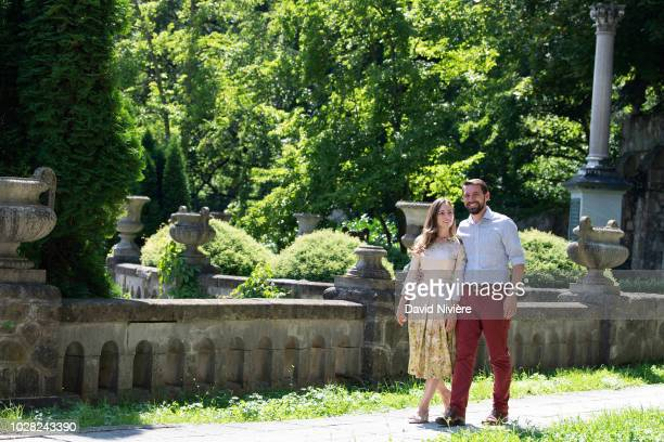 Prince Nicholas Of Romania and Princess Alina Of Romania hold hands while walking at the Peles Castle on August 05 2018 in Sinaia Romania