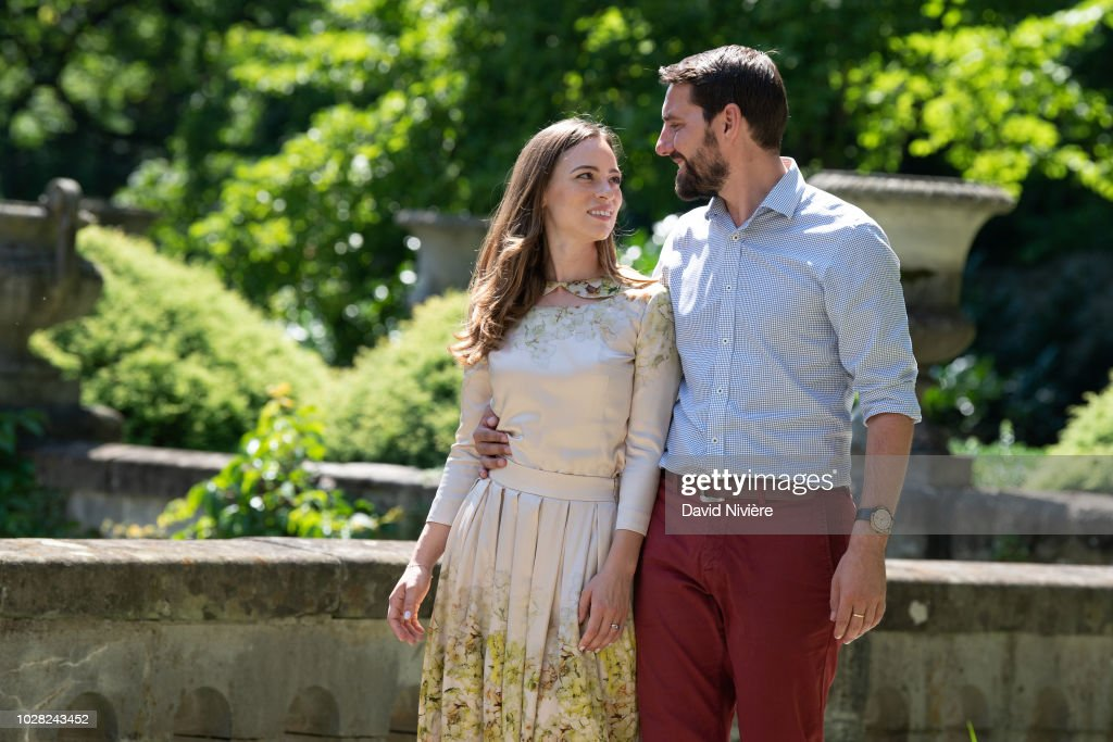 Prince Nicholas Of Romania and Princess Alina Of Romania hold hands while walking at the Peles Castle on August 05, 2018 in Sinaia, Romania.