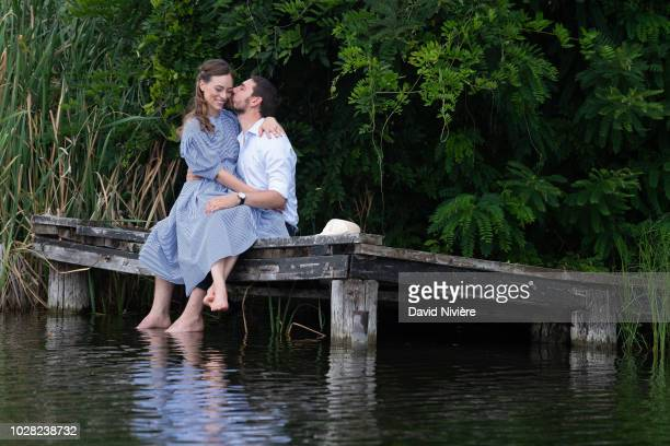 Prince Nicholas Of Romania and Princess Alina Of Romania kiss during a summer photo session in a public park on August 04 2018 in Bucharest Romania