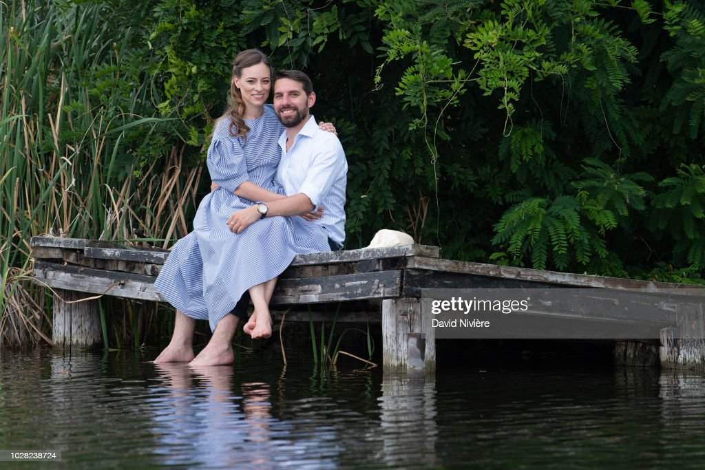 Prince Nicholas Of Romania and Princess Alina Of Romania pose during a summer photo session in a public park on August 04, 2018 in Bucharest, Romania.