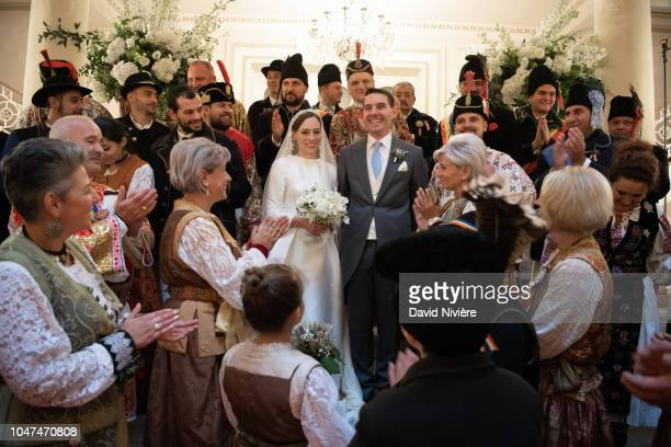Prince Nicholas of Romania and Princess Alina of Romania pose during the official picture with people in Romanian traditional dress at Casino of...